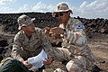 US Navy 071204-N-3931M-078 Republic of Korea Army Maj. Youngjin Kim from Combined Joint Task Force Horn of Africa (CJTF-HOA) and U.S. Marine Corps Maj. Guy Ravey, discuss range operations at the Gordia bombing range off the coa.jpg