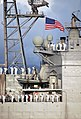 US Navy 071207-N-0879R-078 Sailors aboard the guided-missile cruiser USS Lake Erie (CG 70) render honors to Pearl Harbor survivors during a joint U.S. Navy-National Park Service ceremony.jpg