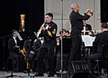 US Navy 071219-N-0773H-165 Senior Chief Musician Timothy E. Roberts performs a solo on a soprano saxophone during the Navy Band performance of Concerto for Soprano Sax and Wind Ensemble at the 61st annual Midwest Clinic.jpg