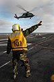 US Navy 080109-N-0640K-005 Aviation Boatswain's Mate (Handling) 3rd Class Alexis Fernandez directs an MH-60S Seahawk helicopter, assigned to the.jpg