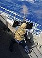 US Navy 080915-N-1082Z-013 Gunners Mate 1st Class Robert E. Lambert fires a .50 caliber machine gun during a live fire exercise aboard the guided-missile cruiser USS Vella Gulf (CG 72).jpg
