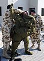 US Navy 090115-N-8730P-003 Bahrain Royal Field Engineers don a bomb suit before a bomb disposal training scenario at a Bahraini military training range during Neon Response 2009.jpg