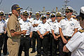 US Navy 090507-N-7441H-001 Cmdr. Troy Jackson, commanding officer of attack submarine USS Norfolk (SSN 714), greets a group of naval officers from Chile, Argentina and Spain arriving for a tour aboard the nuclear submarine.jpg