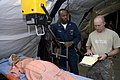 US Navy 091012-N-9123L-045 Hospital Corpsman 2nd Class Alvin Cotson and Air Force Sgt. Clifford Gentry prepare to X-ray a patient at the Humanitarian Assistance Rapid Response Team (HARRT) medical facility in Padang, Indonesia.jpg