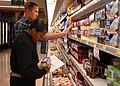 US Navy 100526-N-9520G-001 Sailors look over a list of grocery items during a healthy choices scavenger hunt supporting Commissary Awareness Month.jpg