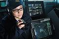 US Navy 100716-N-6863R-027 Operations Specialist Seaman Rita Ortiz stands a sound-powered telephone watch aboard the aircraft carrier USS Carl Vinson (CVN 70).jpg