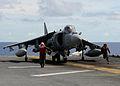 US Navy 100920-N-5538K-224 Marine aviation ordnancemen move away from a AV-8B Harrier jet aircraft after arming a GBU-12 Paveway II laser guided bo.jpg