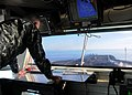 US Navy 101105-N-1004S-105 Capt. Thom Burke, commanding officer of the aircraft carrier USS Ronald Reagan (CVN 76), watches from the bridge as Comm.jpg