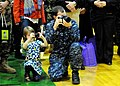US Navy 101205-N-0687C-070 Mass Communication Specialist 2nd Class Jason Tross shows his daughter what he does as a Reserve Component Sailor during.jpg