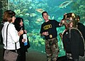 US Navy 110124-N-4397B-010 Chief Navy Diver Kevin Moore talks about the MK-5 diving suit with visitors to the Coral Reef exhibit at the Florida Aqu.jpg