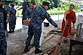 US Navy 111024-N-WW409-008 Sailors assigned to the guided-missile destroyer USS Mustin (DDG 89) gather brooms from a Buddhist monk during a communi.jpg