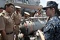 US Navy 111101-N-EA192-051 Gunner's Mate 3rd Class Katherine Curtis explains how the ship's torpedo launcher works.jpg