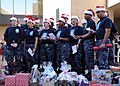 US Navy 111207-N-KR503-176 Members of the First Class Petty Officer Association at Naval Medical Center San Diego sing a holiday song during their.jpg