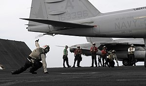 US Navy 120105-N-RG587-371 Troubleshooters assigned to Electronic Attack Squadron (VAQ) 134 signal that an EA-6B Prowler is ready for launch.jpg