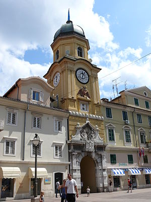 Rijeka - The Baroque city clock tower above the arched gateway linking the Korzo to the inner city, designed by Filbert Bazarig in 1876