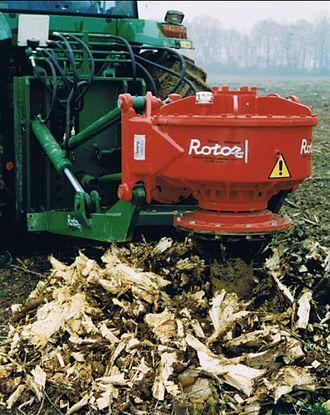 Stump grinder - Rotor vertical stump grinder at work.