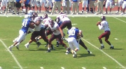 Tech quarterback Marcus Vick (far right), seen here against Duke, was expected by many commentators to have a winning game against Florida State. Vick back to pass against Duke.jpg
