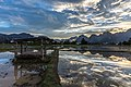 Water reflection of a wodden hut and colorful sky in a paddy field at sunset Vang Vieng Laos.jpg