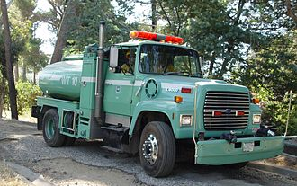 Wildfire suppression - Water Tender ANF 10, from the USDA U.S. Forest Service, Angeles National Forest in the San Gabriel Mountains of the Southern California, Los Angeles Area.  This Type II Tender is staffed by 2 crew members