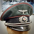 Wehrmacht Heer Panzer (tank) officer's Schirmmütze (visor peaked cap). Army of Nazi Germany. Pink piping, wreath, cocade, metal eagle, woven chin cords. Lofoten World War II Memorial Museum, Norway 2019-05-08 DSC00352 cropped square.jpg