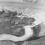 White Glacier, valley glacier with banded ogives, striations in the exposed rocks, September 17, 1972 (GLACIERS 5968).jpg