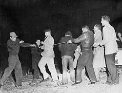 White men and Robeson County indians (Lumbee Indians) in fight-armed skirmish (State's Exhibit No.6). Photo taken by Bill Shaw, Fayetteville Observer newspaper photographer. Photo used as state's (8224422682).jpg