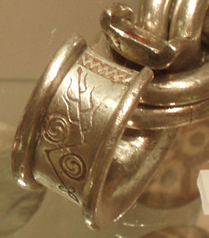 Whitecleuch Chain - Detail of penannular ring, with Pictish symbols