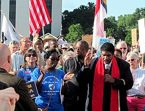 William Barber II - Barber (right) speaking at a Moral Mondays rally in 2013