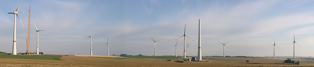 First wind farm consisting of 7.5 megawatt (MW) Enercon E-126 turbines, Estinnes, Belgium, 20 July 2010, two months before completion; note the 2-part blades.