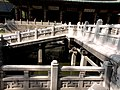 Winged bridge over fish pond.JPG