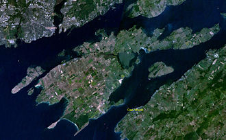 Wolfe Island (Ontario) - NASA image of Wolfe Island. Kingston, Ontario is in the upper left of the image and upstate New York is the landmass in the right corner.