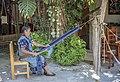 Woman on a backstrap loom in Oaxaca.jpg