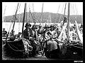 Women sitting on beached skiffs at the Pittwater Regatta (7397780928).jpg