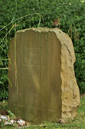 Mike Woodin - Mike Woodin's gravestone in Wolvercote Cemetery, with a juvenile robin perching on it