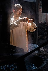 Worker in tannery, Shrinagar, India.jpg