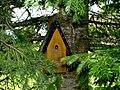 Yellow birdhouse in spruce.jpg
