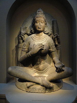Yogi - A 10th-century Yogini statue from Tamil Nadu, India. She is seated in an asana, and her eyes are closed in meditative state.