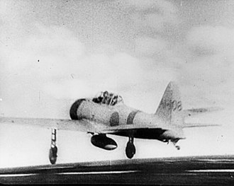 "Naval aviation - A Japanese Mitsubishi A6M2 ""Zero"" fighter launches to attack Pearl Harbor."