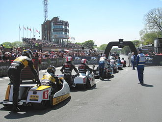 Isle of Man TT - Sidecar TT race competitors line up to start the race