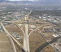 2015-11-03 11 10 42 View east towards Interstate 80's interchange with Interstate 215 and beyond towards downtown Salt Lake City, Utah from an airplane taking off from Salt Lake City International Airport.jpg