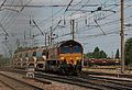 66013 brings up the rear of a lengthy ballast train at Hitchin, July 24, 2011. - panoramio.jpg