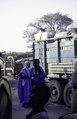 ASC Leiden - van Achterberg Collection - 1 - 164 - Des hommes touaregs ou maures en bleu près d'un camion avec des balles. Autre homme avec téléphone satellite - Léré, Mali - 9-29 novembre 1996.tif