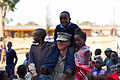 A U.S. Marine and local children watch the opening ceremony for Africa Endeavor (AE) 2013 in Lusaka, Zambia, Aug. 7, 2013 130807-Z-VX744-066.jpg