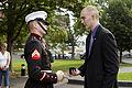 A U.S. Marine corporal, left, speaks with honorary Marine Daran Wankum following a wreath laying ceremony at the Marine Corps War Memorial in Arlington, Va, June 13, 2013 130613-M-KS211-020.jpg
