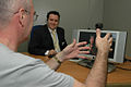 A Video Relay Service session helping a Deaf person communicate with a hearing person via a Video Interpreter (sign language interpreter) and a videophone DSC 0073.JPG