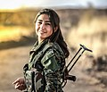 A YPJ fighter smiles for the camera.jpg
