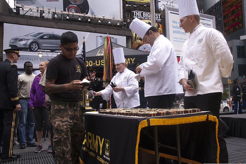 File:A recently sworn-in U.S. Soldier receives a piece of cake after a cake-cutting ceremony at Times Square in New York, June 14, 2013 130614-A-EL344-826.jpg