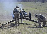 A soldier with the Ukrainian Land Forces fires an 82mm mortar.jpg
