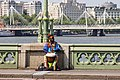 A street musician playing drum on Westminster Bridge.jpg