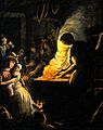 A woman and her baby sitting in a busy blacksmith's forge Wellcome V0049626.jpg